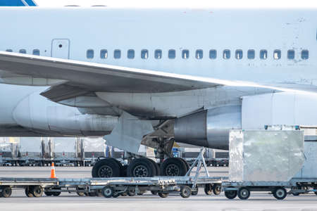 Loading cargo to the plane closeup view 写真素材