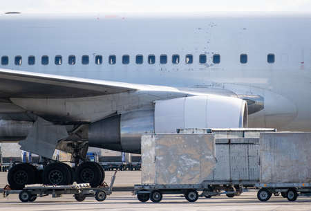 Cargo containers near the passenger plane