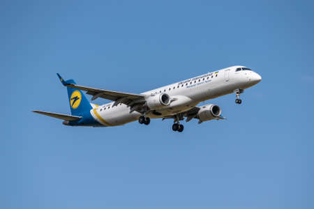 Boryspil, Ukraine - September 25, 2020: Ukraine International Airlines Embraer ERJ-195 is landing in the airport Editorial