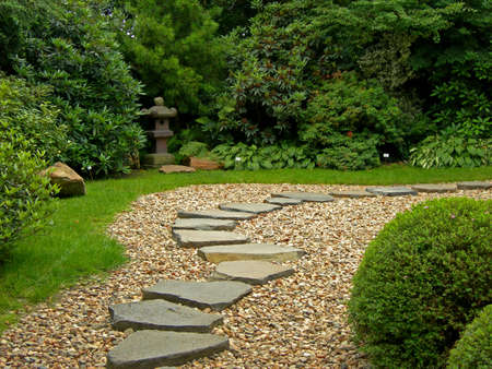 stones with flower:           Zen Path in a Japanese botanical garden in Prague