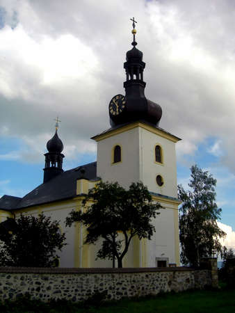 Traditional Czech baroque church located in the country. With dramatic sky photo