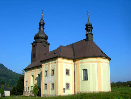 Traditional Czech baroque church located in the country.  photo