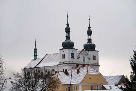 Small church in Czech country is covered by snow in winter Stock Photo - 15630239