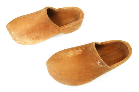 old shoes: A pair of ancient wooden shoes on white  Stock Photo