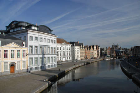gabled: gabled houses along a canal in Gent, Belgium with reflection on the water  Stock Photo