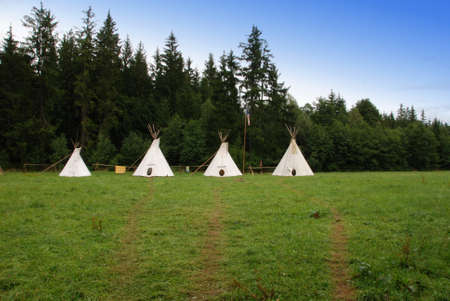 tepee: Row of native American sheleters - teepees Stock Photo