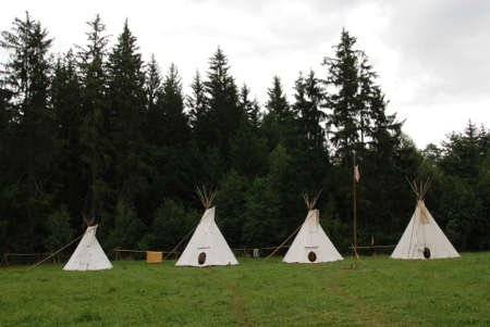 domiciles: Row of native American sheleters - teepees Stock Photo