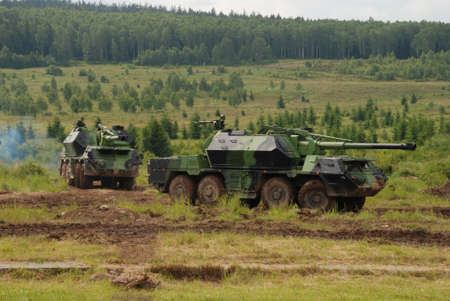 drab: Military vehicle are guarding territory against the enemy
