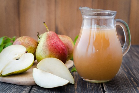 fresh pear juice on a rustic wooden table