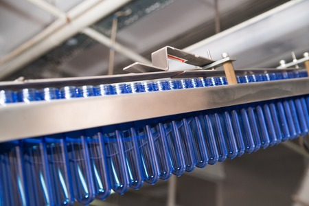 A fragment of conveyor line, blowing plastic bottles from PET preform blanks