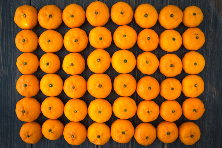 A set of tangerine ranks on black wooden background top view Stock Photo