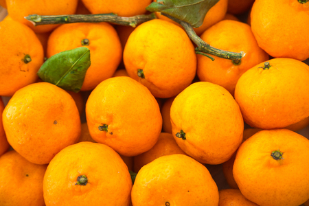 Bright orange tangerines texture pattern background close-up