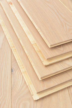 A stack of wooden parquet or laminate flooring boards