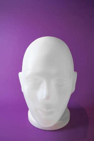 Human head bust on trendy lavender background. Futuristic fashion concept.