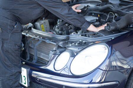 Mechanic performing car maintenance in garage