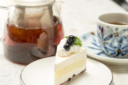 Blueberry cake and tea on the table