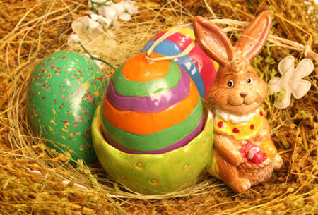 ceramic bunny and easter eggs photo