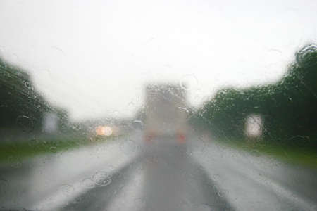 Driving on a highway on a grey rainy day