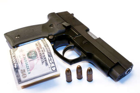 9mm gun and US dollars Standard-Bild