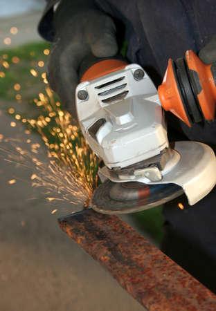 Grinder grinding a metal part