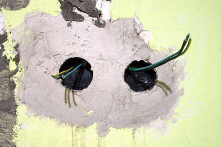 Electrical installation in a building wall Stock Photo