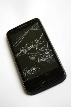 Modern smartphone with broken screen. Stock Photo