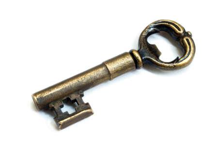 Beautiful golden key at the white background Standard-Bild
