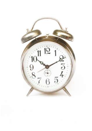 Rustic vintage desk alarm clock at the white background Standard-Bild