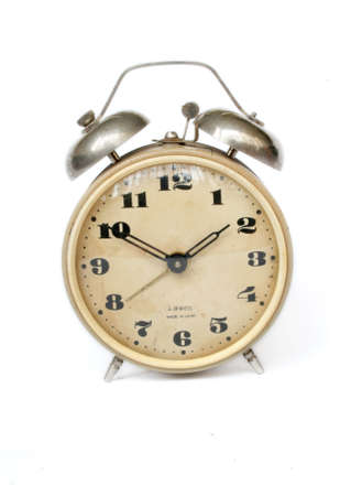 Rustic vintage desk alarm clock at the white background Stock Photo