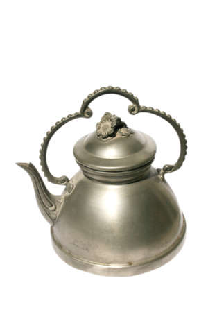 Beautiful decorated antique silver pot at the white background Standard-Bild