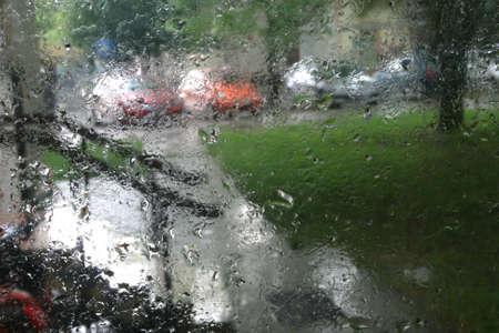 Rain Drops On Glass With City Background Standard-Bild