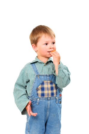 little boy eating cookies on white background isolated