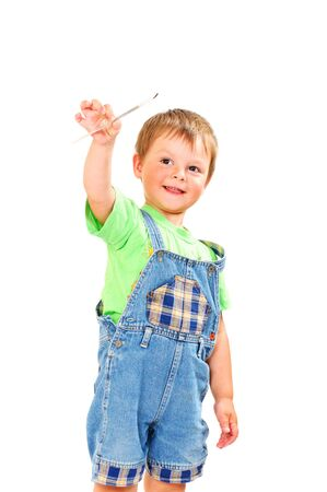 Happy little boy with brush on white background isolated Stock Photo - 9849641