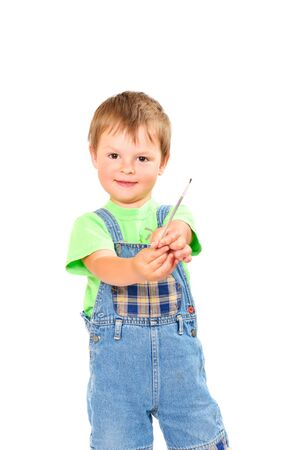 Happy little boy with brush on white background isolated