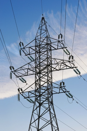 Electric powerlines on blue sky background