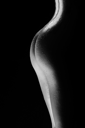 nude woman standing: naked female body with water drops black and white