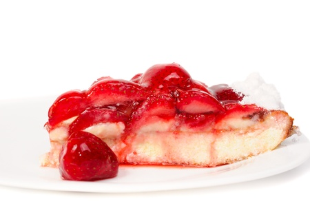 A piece of cake with strawberries on plate Stock Photo - 11027212