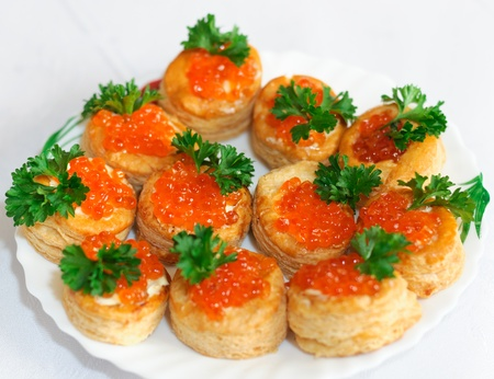 Tartlets with caviar and parsley on a plate photo