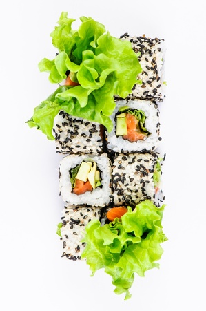 Sushi set with leawes salad on white background photo