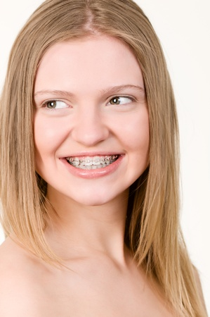 Beautiful young girl with brackets on teeth close up Stock Photo