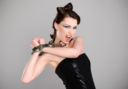 young beautiful woman with chain and makeup studio shot Stock Photo - 13425154