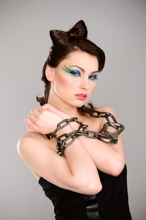 young beautiful woman with chain and makeup studio shot photo