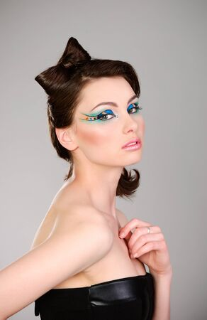young beautiful woman with makeup portrait studio shot