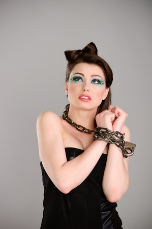 young beautiful woman with chain studio shot photo