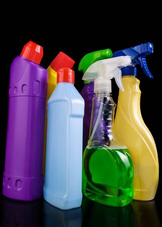 Subjects for sanitary cleaning a house on black background photo