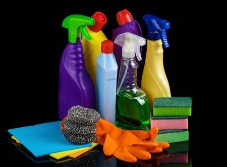 Cleaning set on black background photo