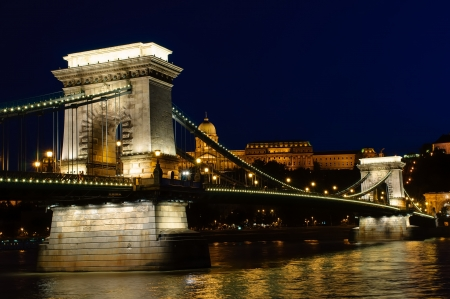 Night view of Chain bridge, Royal Palace and Danube river in Budapest