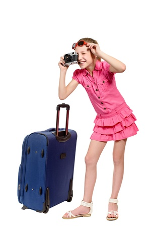girl with suitcase and old style photocamera isolated on white background photo