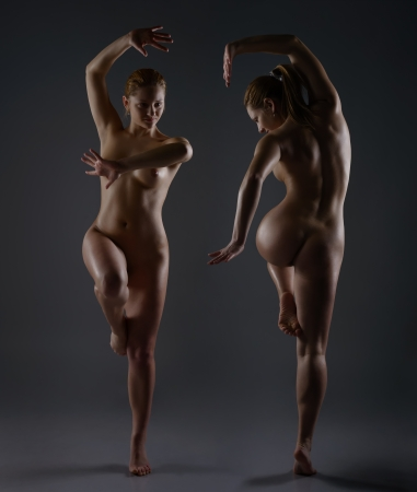 Two Naked female dancer posing in studio