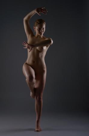 Naked female dancer posing in studio Stock Photo